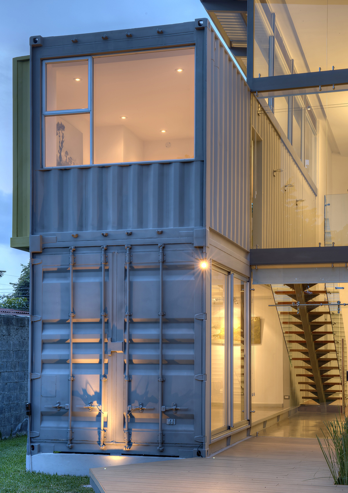 Open and airy casa incubo shipping container home by for Shipping container home plans 2 story