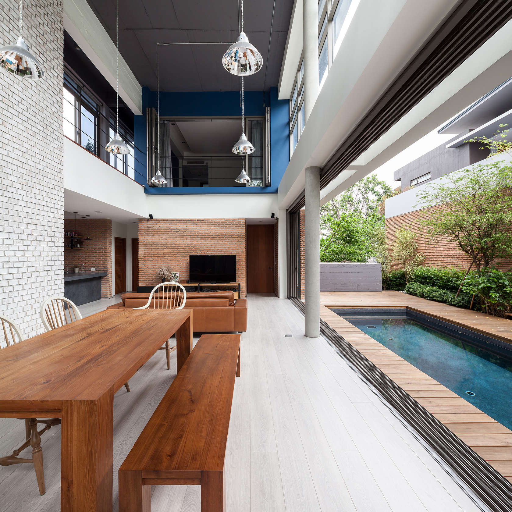TWO ALMOST IDENTICAL HOMES AT NICHADA IN THAILAND BY