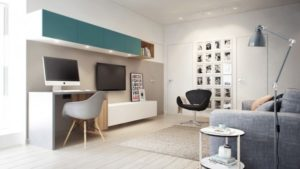 A small desk with overhead storage is practical, but the chair can tuck under for extra floor space or flip around for an instant conversation area. Keeping the desk wall painted the same color all the way across makes the bedroom door nearly disappear, giving the illusion of even more space.