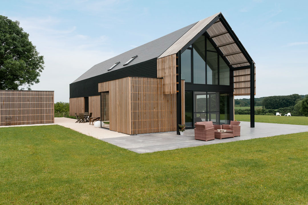 A drastic renovation turns an old barn into a lovely for Modern barn house plans
