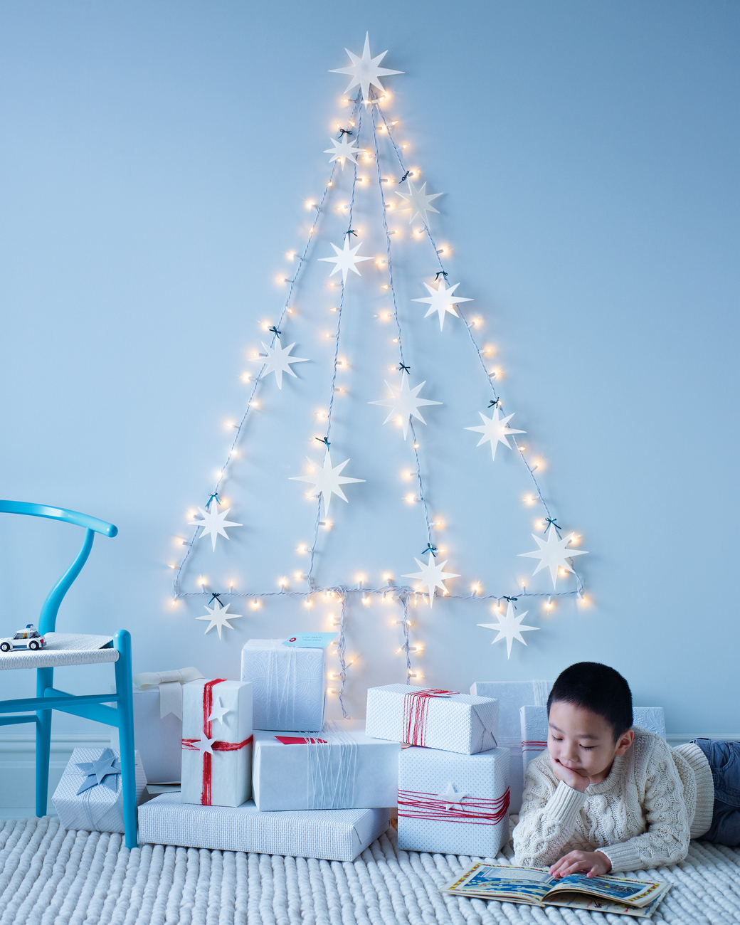 A DIY Christmas tree made from Christmas lights as seen on Martha Stewart.