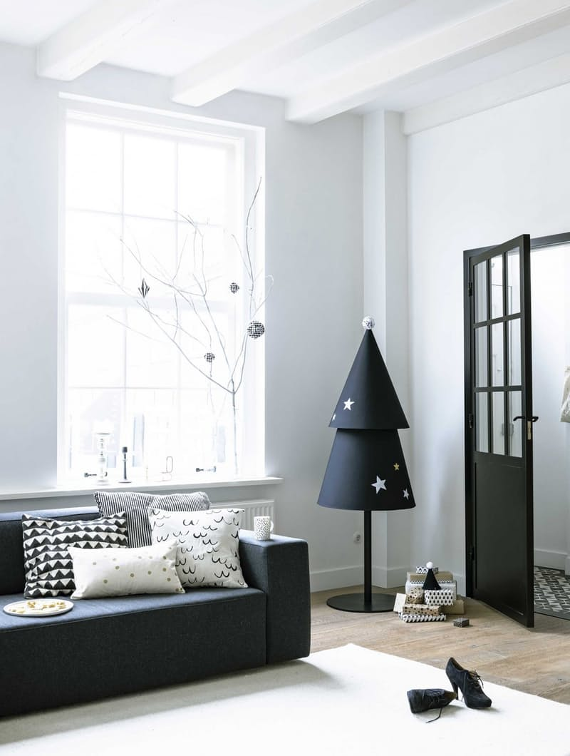 Love this minimalist Christmas tree seen on Apartment Therapy made from two large cone shapes. It's pretty easy to do.