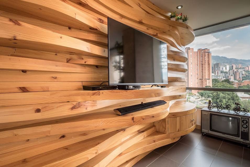 The Wood Accent Wall Also Ties In With The Other Wood Elements In The  Apartment, Making The Open Room Feel Warmer And More Wholistic.