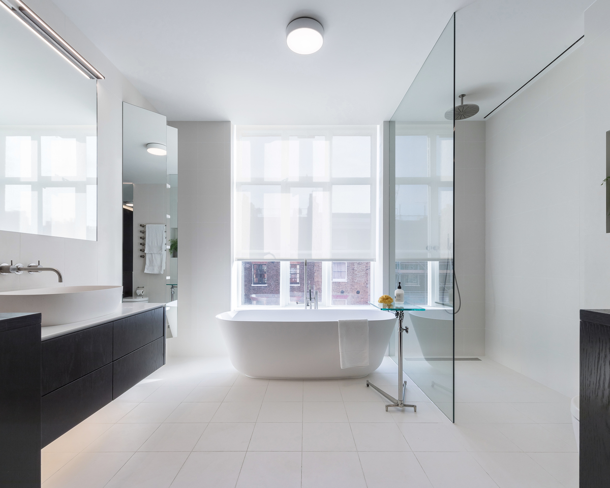 A pristine bathroom design helps revitalise this 40 year old apartment in London.