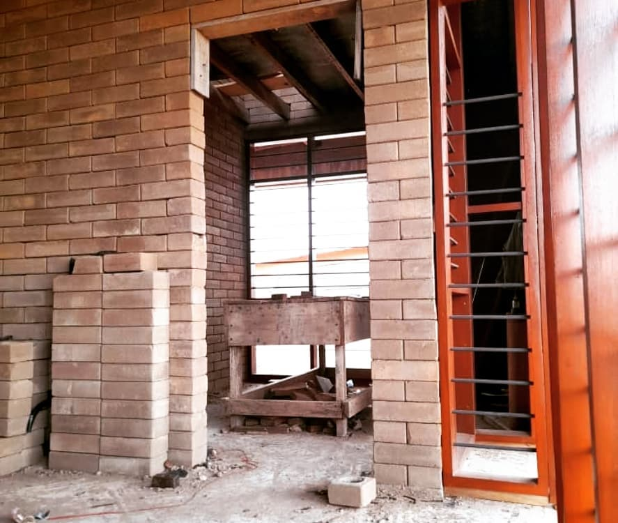 Compressed Earth Bricks inside Pata 4 Two Housing Unit by OOA