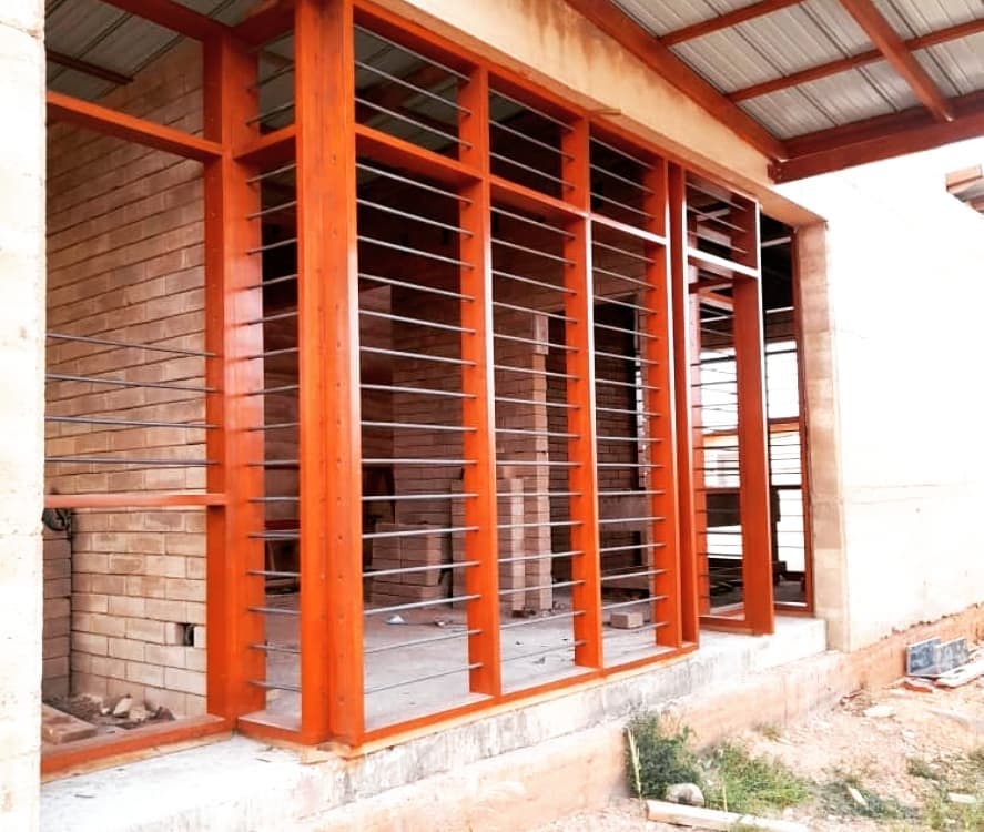 Wood Window Frames in carport of Pata 4 Two Housing Unit by OOA